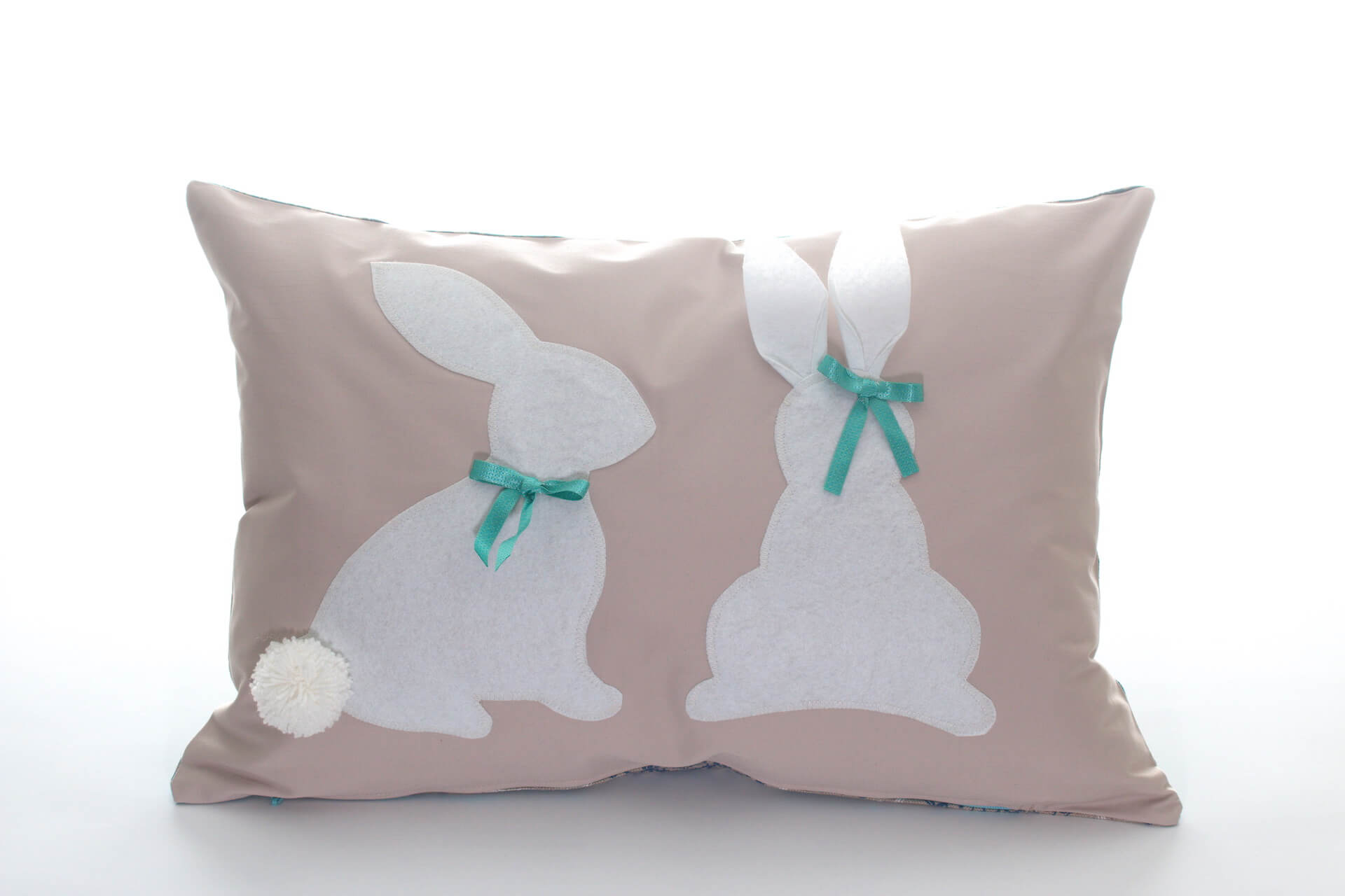 Handmade decorative pillow cream-colored with white bunnies