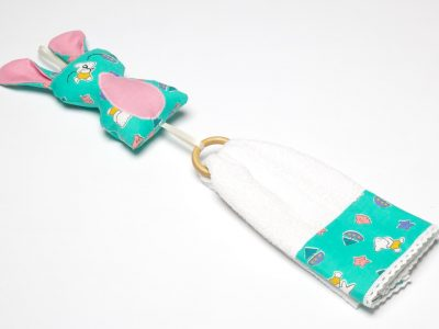 Handmade decorated towel with turquoise bunny toy