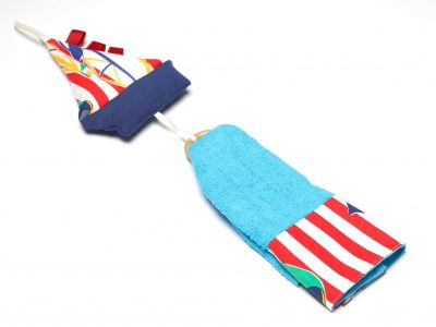 Handmade towel decorated with blue boat toy