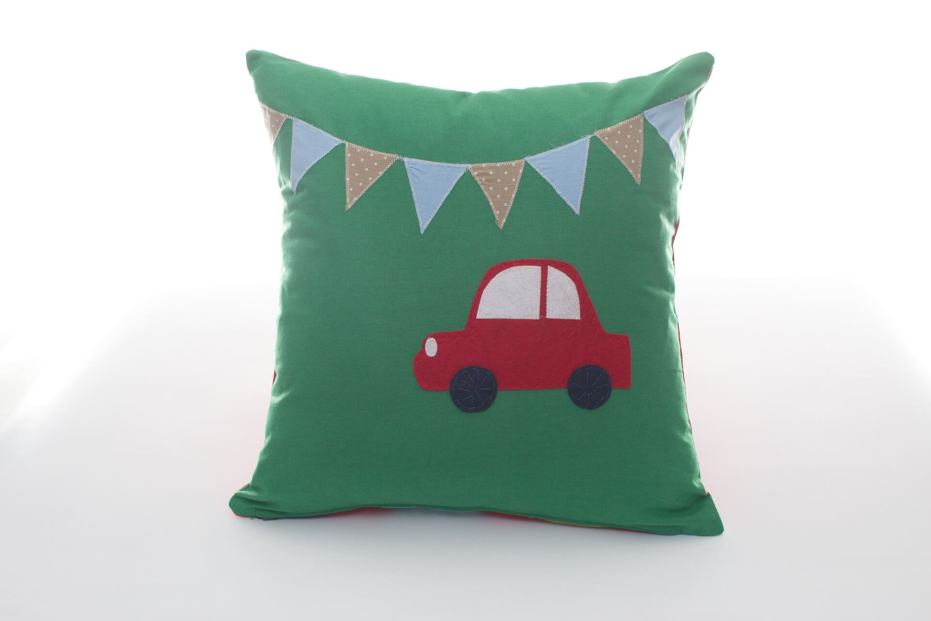 Handmade decorative pillow with red car